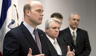 Southern District of Iowa United States Attorney Matthew Whitaker, left,  speaks during a news conference, Thursday, Feb. 12, 2009, in Des Moines, Iowa. Federal authorities announced the arrests and indictments of 11 people in six states as part of an investigation into visa and mail fraud.  (AP Photo/Charlie Neibergall)