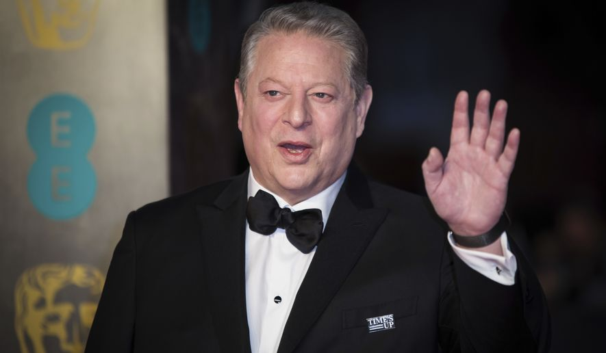 Al Gore poses for photographers upon arrival at the BAFTA Film Awards, in London, Sunday, Feb. 18, 2018. (Photo by Vianney Le Caer/Invision/AP)