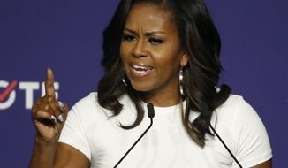 Former first lady Michelle Obama speaks at a rally to encourage voter registration Sunday, Sept. 23, 2018, in Las Vegas. (AP Photo/John Locher) ** FILE **