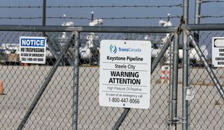 The Keystone pumping station, into which the planned Keystone XL pipeline is to connect to, is seen in Steele City, Neb., Tuesday, Nov. 3, 2015. TransCanada, the company behind the project, said Monday it had asked the State Department to suspend its review of the Canada-to-Texas pipeline, citing uncertainties about the route it would take through Nebraska. (AP Photo/Nati Harnik)