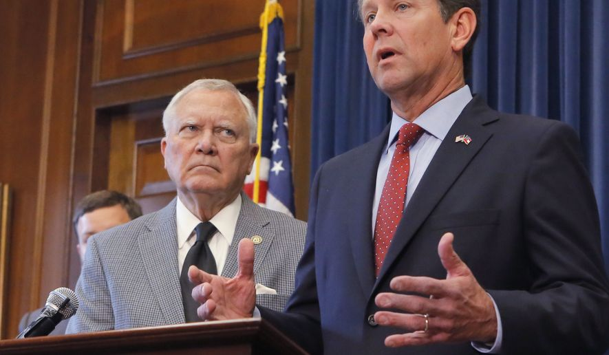 Republican Brian Kemp, right, speaks during a news conference as Georgia Gov. Nathan Deal listens in the Governor's ceremonial office at the Capitol on Thursday, Nov. 8, 2018, in Atlanta, Ga. Kemp resigned Thursday as Georgia's secretary of state, a day after his campaign said he's captured enough votes to become governor despite his rival's refusal to concede. (Bob Andres/Atlanta Journal-Constitution via AP)
