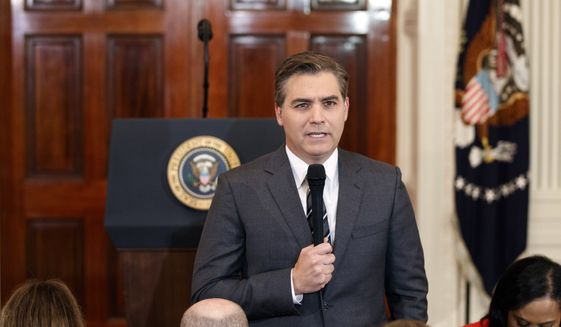 In this Nov. 7, 2018, photo, CNN journalist Jim Acosta does a standup before a new conference with President Donald Trump in the East Room of the White House in Washington. (AP Photo/Evan Vucci)