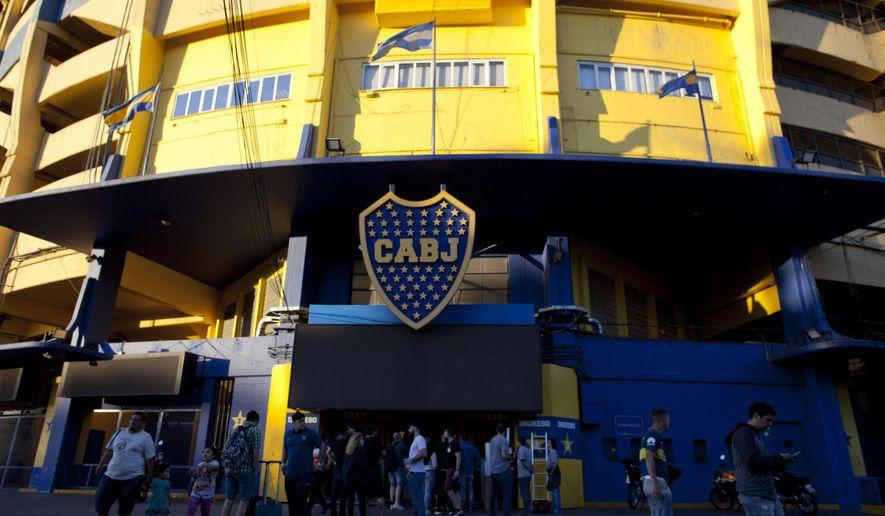 People stand outside Boca Juniors stadium in Buenos Aires, Argentina Wednesday, Nov. 7, 2018. Boca Juniors will face Play River Plate for the Copa Libertadores final match. (AP Photo/Natacha Pisarenko)