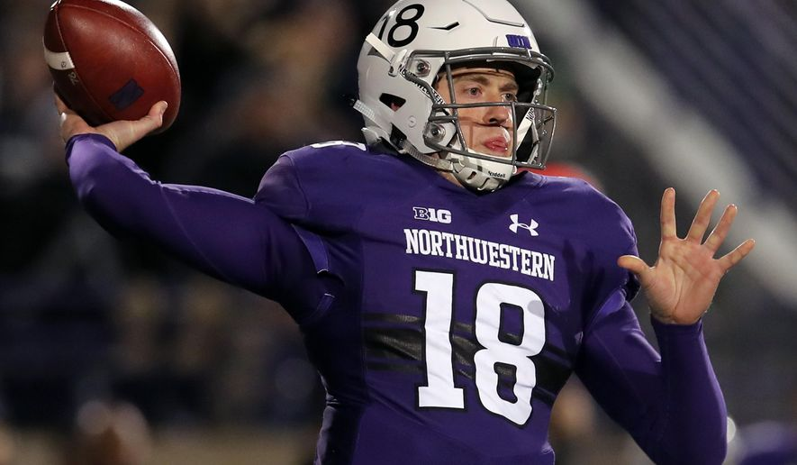 FILE- In this Saturday, Nov. 3, 2018, file photo, Northwestern's Clayton Thorson makes a pass against Notre Dame during the first half of an NCAA college football game in Evanston, Ill. Northwestern faces Iowa on Saturday. (AP Photo/Jim Young) ** FILE **