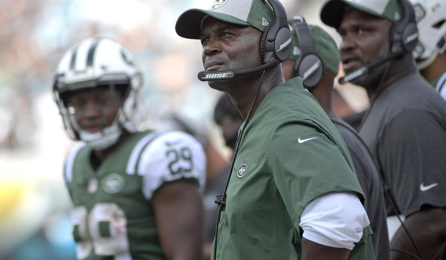 FILE- In this Sept. 30, 2018, file photo, New York Jets head coach Todd Bowles, center, watches from the sideline during the second half of an NFL football game against the Jacksonville Jaguars in Jacksonville, Fla. Two struggling AFC East rivals with uncertain quarterback situations square off when the Buffalo Bills and New York Jets meet on Sunday. (AP Photo/Phelan M. Ebenhack, File)