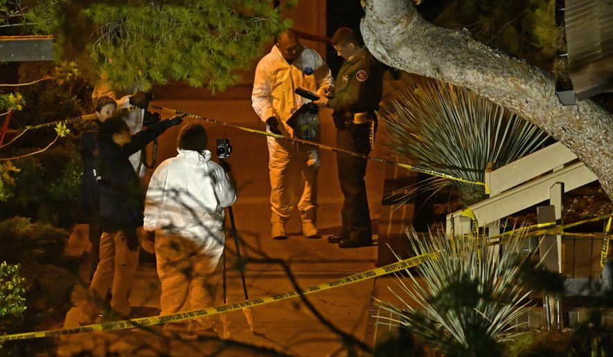 """A forensics team works the scene Thursday, Nov. 8, 2018, in Thousand Oaks, Calif. where a gunman opened fire Wednesday inside a country dance bar crowded with hundreds of people on """"college night,"""" wounding 11 people including a deputy who rushed to the scene. Ventura County sheriff's spokesman says gunman is dead inside the bar. (AP Photo/Mark J. Terrill)"""