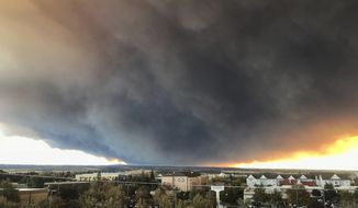 The massive plume from the Camp Fire, burning in the Feather River Canyon near Paradise, Calif., wafts over the Sacramento Valley as seen from Chico, Calif., on Thursday, Nov. 8, 2018. Authorities in Northern California have ordered mandatory evacuations in a rural area where the wildfire has grown to 1,000 acres (405 hectares) amid hot and windy weather. (David Little/Chico Enterprise-Record via AP)