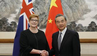 Australian Foreign Minister Marise Payne, left, shakes hands with her Chinese counterpart Wang Yi at the Diaoyutai State Guesthouse in Beijing, China, Thursday, Nov. 8, 2018. The foreign ministers of China and Australia are meeting in Beijing on Thursday in a sign of a thaw in the recently frosty relationship between the key economic partners. (Thomas Peter/Pool Photo via AP)