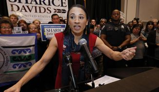 FILE - In this Tuesday, Nov. 6, 2018 file photo, Democrat house candidate Sharice Davids speaks to supporters at a victory party in Olathe, Kan. Davids defeated Republican incumbent Kevin Yoder to win the Kansas' 3rd Congressional District seat. Democratic House candidate Debra Haaland who won in New Mexico's 1st congressional district and Davids will join U.S. Reps. Tom Cole, who is Chickasaw, and Markwayne Mullin, an enrolled citizen of the Cherokee Nation, in the House. (AP Photo/Colin E. Braley, File)