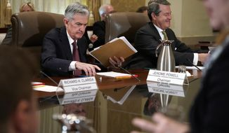 FILE- In this Oct. 31, 2018, file photo Federal Reserve Chair Jerome Powell, left, and Randal Quarles, vice chair for supervision, gather their things at the end of a Federal Reserve Board meeting at the Marriner S. Eccles Federal Reserve Board Building in Washington. On Thursday, Nov. 8, the Federal Reserve releases its latest monetary policy statement after a two-day meeting. (AP Photo/Jacquelyn Martin, File)