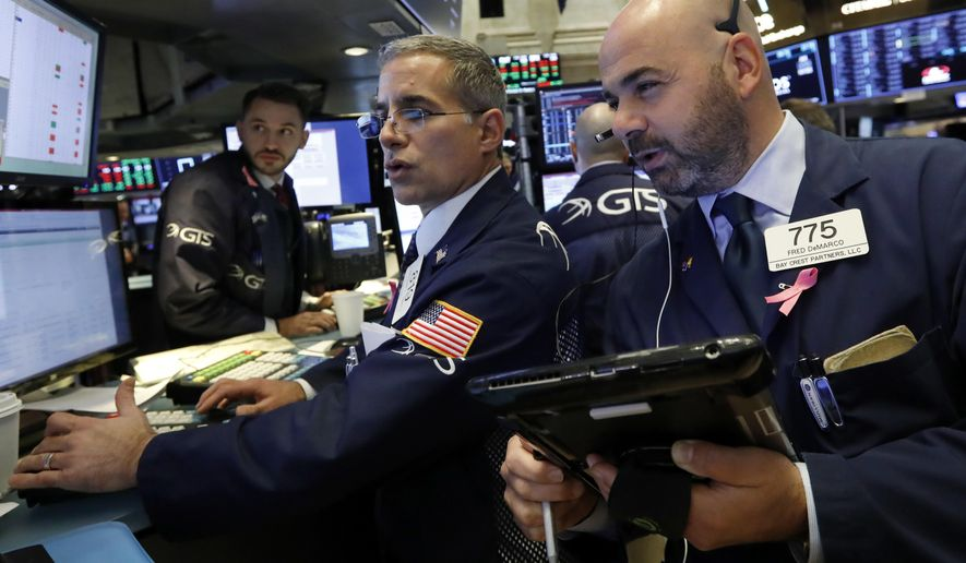 FILE- In this Oct. 26, 2016, file photo specialist Anthony Rinaldi, left, works with trader Fred DeMarco on the floor of the New York Stock Exchange. The U.S. stock market opens at 9:30 a.m. EDT on Thursday, Nov. 8. (AP Photo/Richard Drew, File)