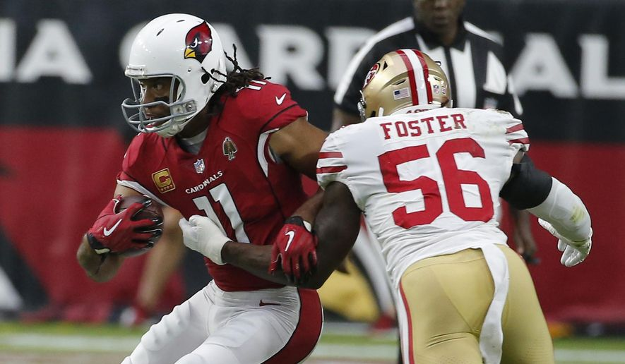 FILE - In this Oct. 28, 2018, file photo, Arizona Cardinals wide receiver Larry Fitzgerald (11) runs with the ball during the team's NFL football game against the San Francisco 49ers in Glendale, Ariz. Fitzgerald is closing in on another milestone, and it's an impressive one. The 35-year-old receiver needs to catch just 33 yards of passes Sunday at Kansas City to move past Hall of Famer Terrell Owens into second place in the NFL's all-time yards receiving list. (AP Photo/Rick Scuteri, File)