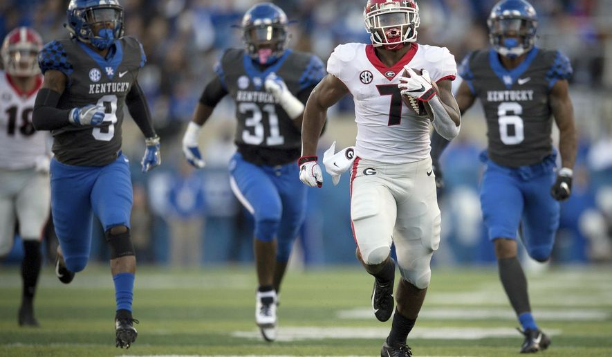 FILE - In this Saturday, Nov. 3, 2018, file photo, Georgia running back D'Andre Swift (7) runs for a touchdown during the second half an NCAA college football game against Kentucky in Lexington, Ky. The Bulldogs have produced dynamic running backs over the years, from Herschel Walker to Todd Gurley. The trend continues this season with Holyfield and D'Andre Swift.  (AP Photo/Bryan Woolston, File)