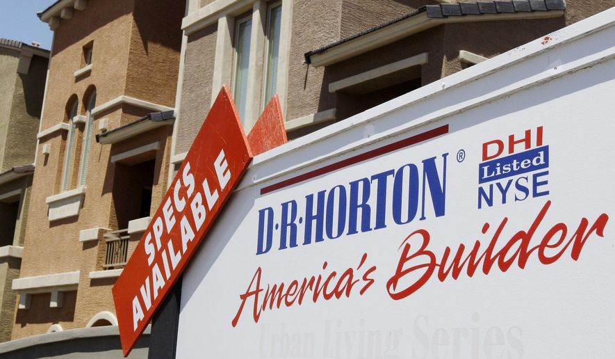 FILE - In this May 7, 2009 file photo, homes built by D.R. Horton Inc. are shown in Cahndler, Ariz. Major homebuilders are taking a beating on Wall Street as rising interest rates and home prices continue to keep potential buyers on the sidelines. Shares in leading U.S. homebuilder D.R. Horton have fallen more than 8 percent in Thursday, Nov. 8, 2018, morning trading while others in the sector saw declines between 4 percent and 6 percent. (AP Photo/Ross D. Franklin, File)
