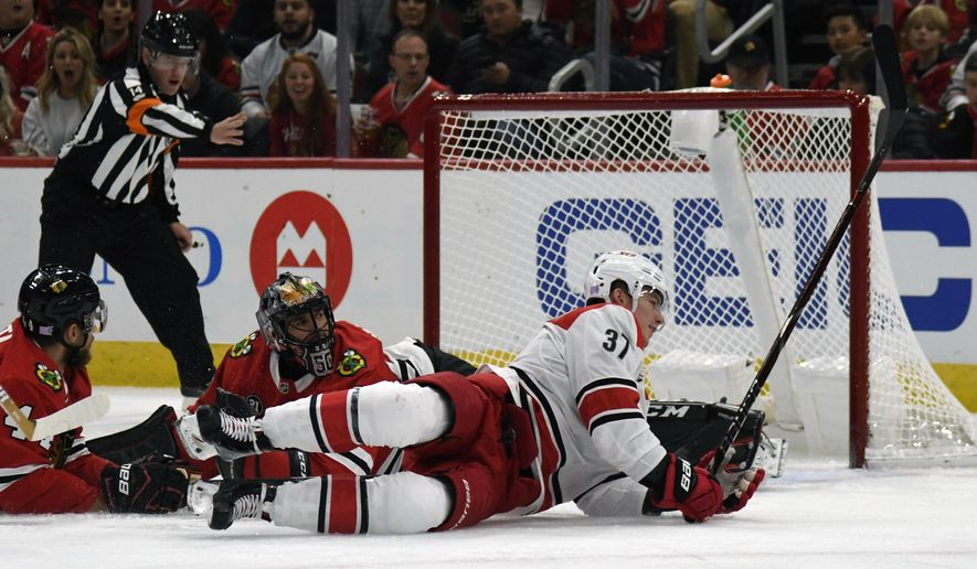 Carolina Hurricanes right wing Andrei Svechnikov (37) scores a goal on Chicago Blackhawks goaltender Corey Crawford (50) during the first period of an NHL hockey game Thursday, Nov. 8, 2018, in Chicago. (AP Photo/David Banks)