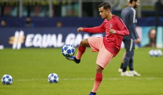 Barcelona's Philippe Coutinho warms up prior to the Champions League group B soccer match between Inter Milan and Barcelona at the San Siro stadium in Milan, Italy, Tuesday, Nov. 6, 2018. (AP Photo/Antonio Calanni)