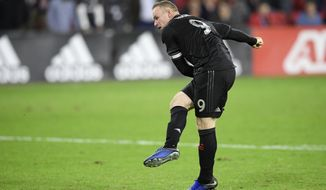 D.C. United forward Wayne Rooney follows through on his kick during a penalty kick shootout of an MLS playoff soccer match against the Columbus Crew, Thursday, Nov. 1, 2018, in Washington. Rooney's kick as saved by Columbus goalkeeper Zack Steffen. Columbus won 3-2 on penalty kicks. (AP Photo/Nick Wass) ** FILE **