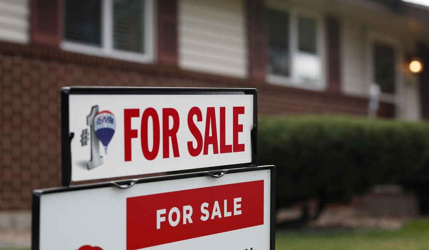 FILE- In this Oct 2, 2018, file photo a for sale sign stands outside a home on the market in the north Denver suburb of Thornton, Colo. On Thursday, Nov. 8, Freddie Mac reports on this week's average U.S. mortgage rates. (AP Photo/David Zalubowski, File)