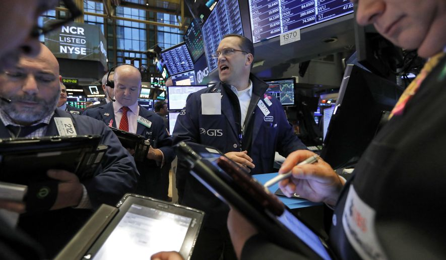FILE- In this Wednesday, Nov. 7, 2018, file photo traders gather at the post of Anthony Matesic, center, on the floor of the New York Stock Exchange. The past decade has seen an explosion in new exchange-traded funds. Investors have flocked to ETFs because they trade like individual stocks, but offer the diversification benefits of mutual funds, all at a low cost. But not all funds attract investors, and ETFs are dying off at a near-record rate this year. (AP Photo/Richard Drew, File)