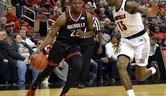 Nicholls State forward Brandon Moore Jr. (22) attempts to drive past the defense of Louisville forward V.J. King (13) during the first half of an NCAA college basketball game, in Louisville, Ky., Thursday, Nov. 8, 2018. (AP Photo/Timothy D. Easley)