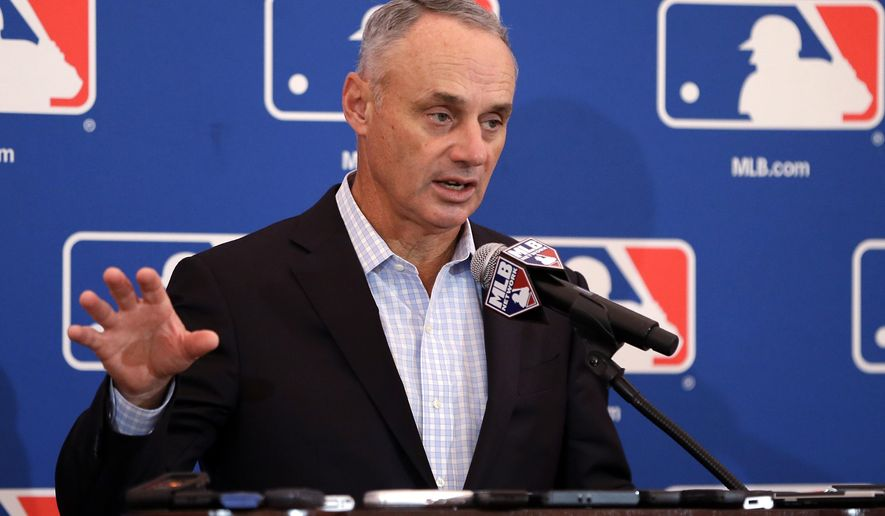 FILE - In this Nov. 16, 2017, file photo, baseball Commissioner Rob Manfred speaks during a news conference at the annual MLB owners meetings in Orlando, Fla. A person familiar with the agenda tells The Associated Press that owners plan to vote on a new term for Manfred, a new television contract with Fox and an agreement for in-game cut-ins with the subscription video streaming service DAZN when they meet next week in Atlanta. (AP Photo/John Raoux, File)