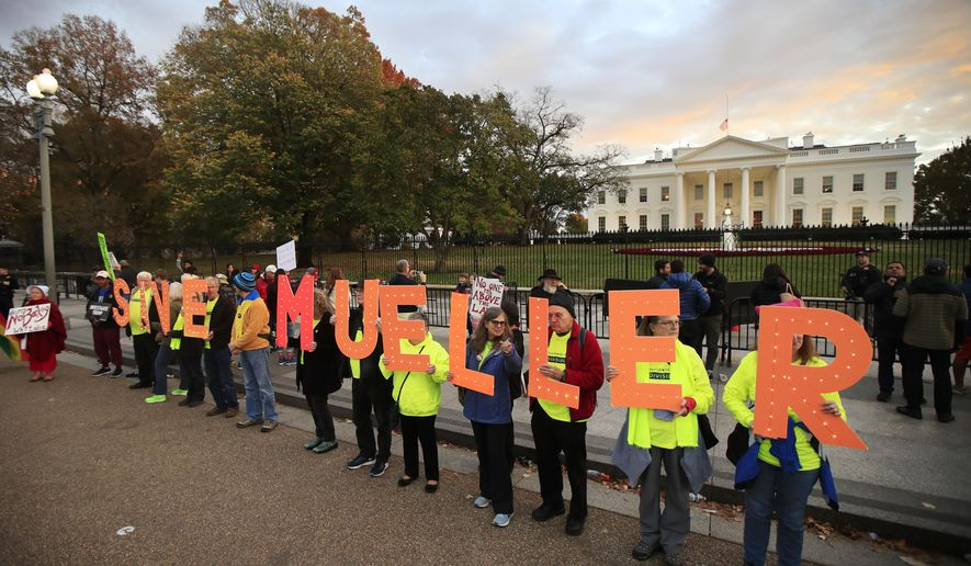 "Protestors gather in front of the White House in Washington, Thursday, Nov. 8, 2018, as part of a nationwide ""Protect Mueller"" campaign demanding that acting U.S. Attorney General Matthew Whitaker recuse himself from overseeing the ongoing special counsel investigation. (AP Photo/Manuel Balce Ceneta)"