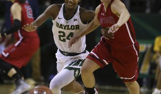 Saint Francis guard Karson Swogger, right, and Baylor guard Chloe Jackson chase the ball during the first half of an NCAA college basketball game Thursday, Nov. 8, 2018, in Waco, Texas. (AP Photo/Rod Aydelotte)