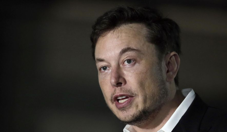 In this June 14, 2018, file photo, Tesla CEO Elon Musk speaks at a news conference in Chicago. Tesla has announced that Robyn Denholm of Australia's Telstra will become its new board chair. Musk agreed to vacate his post as board chairman as part of a settlement with U.S. regulators of a lawsuit alleging he duped investors with misleading statements about a proposed buyout of the company. (AP Photo/Kiichiro Sato, File)
