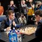 World chess champion Magnus Carlsen of Norway (left) ponders a move early in the first game of the title match with U.S. grandmaster Fabiano Caruana in London on Nov. 9. (FIDE)