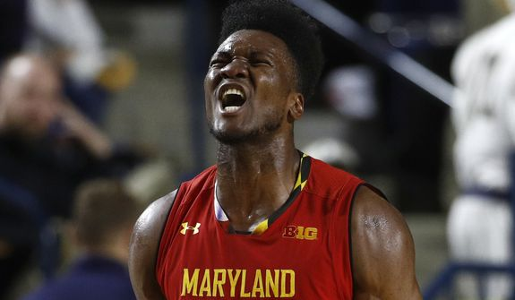 Maryland forward Bruno Fernando reacts after Maryland gained possession of the ball in the second half of an NCAA college basketball game against Navy at the Veterans Classic tournament in Annapolis, Md., Friday, Nov. 9, 2018. (AP Photo/Patrick Semansky) **FILE**