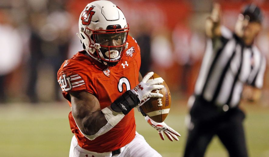 FILE - In this Oct. 20, 2018, file photo, Utah running back Zack Moss (2) carries the ball in the second half during an NCAA college football game against Southern California in Salt Lake City. The big question facing Utah when it hosts Oregon is whether Jason Shelley can pick up where Tyler Huntley left off. The Utes will need Shelley to adjust to his new role quickly after losing Moss to a knee injury. Moss suffered the injury at practice on Wednesday and now will require season-ending surgery. (AP Photo/Rick Bowmer) ** FILE **