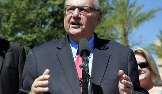 FILE--In this May 22, 2018, file photo, former Maricopa County Sheriff Joe Arpaio speaks during a campaign event in Phoenix. Maricopa County is opposing a request to give Latinos who were illegally detained when Arpaio defied a 2011 court order six more months to apply for taxpayer-funded compensation. Immigrant rights advocates say more time is needed to locate the victims. (AP Photo/Matt York, File)