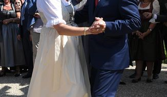 FILE -- In this Saturday, Aug. 18, 2018 photo Russian President Vladimir Putin, right, dances with Austrian Foreign Minister Karin Kneissl as he attends the wedding of Kneissl with Austrian businessman Wolfgang Meilinger in Gamlitz, southern Austria. (Roland Schlager/Pool photo via AP)