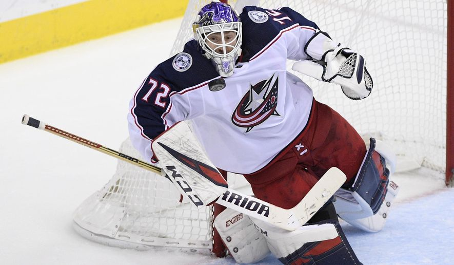 Columbus Blue Jackets goaltender Sergei Bobrovsky (72), of Russia, stops the puck during the third period of an NHL hockey game against the Washington Capitals, Friday, Nov. 9, 2018, in Washington. The Blue Jackets won 2-1. (AP Photo/Nick Wass)