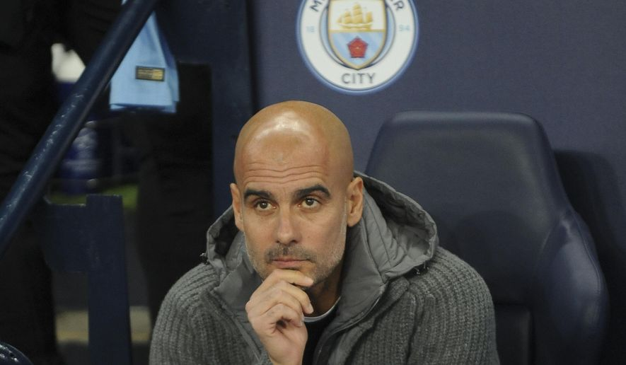 Manchester City coach Pep Guardiola looks on before the Champions League Group F soccer match between Manchester City and Shakhtar Donetsk at Etihad stadium in Manchester, England, Wednesday, Nov. 7, 2018. (AP Photo/Rui Vieira)