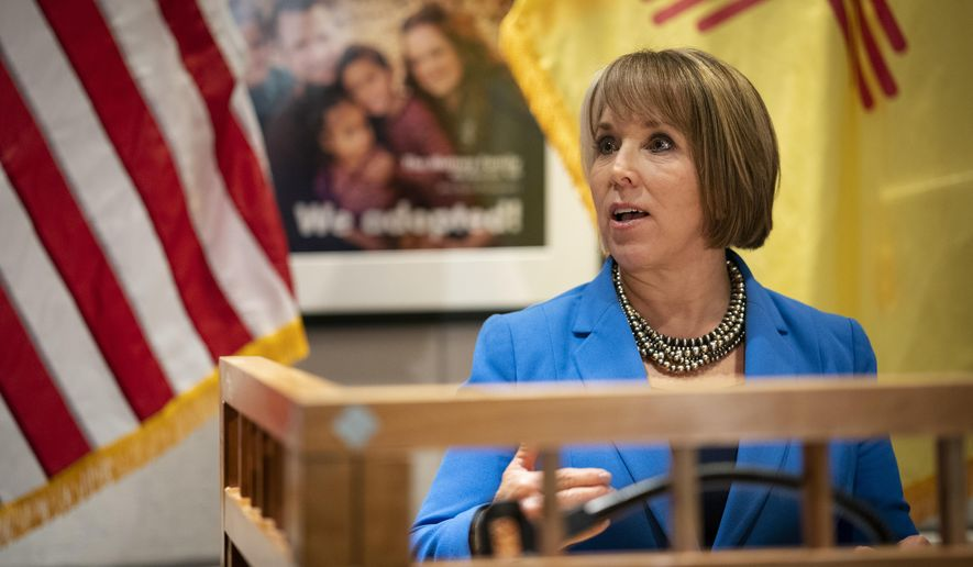 U.S. Rep. Michelle Lujan Grisham, who was elected Tuesday as the state's next governor, answers questions at a joint press conference with New Mexico Gov. Susana Martinez at the State Capitol in Santa Fe, N.M., on Friday, Nov. 9, 2018. Martinez, a Republican and the state's first female governor, has served two consecutive terms. Lujan Grisham, a Democrat, will take office Jan. 1, 2019. (AP Photo/Craig Fritz)
