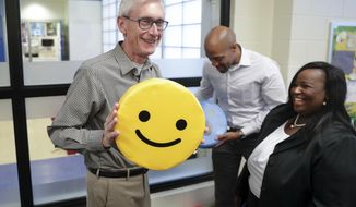 Governor-elect Tony Evers, left, and Lt. Governor-elect Mandela Barnes, right, with pillows found on the tour of the Boys & Girls Club of Dane County. State Rep-elect Shelia Stubbs (D-Madison) is right. On Wednesday Nov. 7, 2018 Governor-elect Tony Evers, and Lt. Governor elect Mandela Barnes took a tour of the Boys & Girls Club of Dane County in Madison, Wis. (Steve Apps/Wisconsin State Journal via AP)