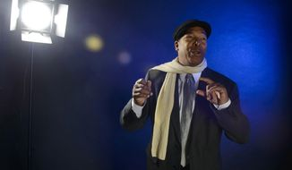 "In this Oct. 30, 2018 photo, Terry Sanford teacher Brian Mayers performs a section of his play called ""The Cycle"" during a portrait session in Fayetteville, N.C. Mayers' play was produced in New York and performed during the United Solo Theatre Festival. His wife, Toni Henderson-Mayers, directed the play. (Melissa Sue Gerrits/The Fayetteville Observer via AP)"