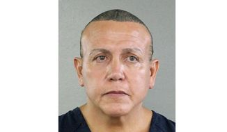 In this undated photo released by the Broward County Sheriff's office, Cesar Sayoc is seen in a booking photo, in Miami. Sayoc, accused of sending pipe bombs to prominent critics of President Donald Trump has been indicted on charges carrying a potential penalty of life in prison. The 30-count indictment in Manhattan federal court was filed on Friday, Nov. 9, 2018 against Sayoc. (Broward County Sheriff's Office via AP)