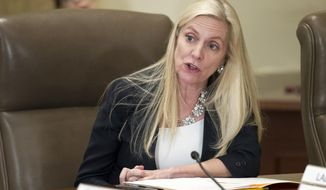 """FILE- In this June 14, 2018, file photo Federal Reserve Board Governor Lael Brainard participates in an open meeting in Washington. The Federal Reserve says it will begin issuing a new report assessing the stability of the U.S. financial system. Brainard says that the 2008 financial crisis showed that a """"resilient financial system is critical for a healthy economy."""" (AP Photo/Cliff Owen, File)"""