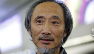 In this Nov. 9, 2018, photo, Chinese dissident writer Ma Jian speaks to media after arriving Hong Kong international airport. Concerns have been raised about freedom of expression in Hong Kong following the cancellation of literary and artistic events and the refusal to allow a Financial Times editor to enter the semi-autonomous Chinese territory. The author Ma Jian is still planning to enter the city amid plans to arrange an alternative venue, while Chinese-Australian artist Badiucao's show was called-off after alleged threats from Chinese authorities. Financial Times' Victor Mallet was turned around at the airport. (AP Photo/Kin Cheung)