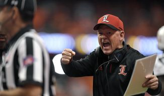 Louisville head coach Bobby Petrino tries to get the referees attention during the first half of an NCAA college football game against Syracuse in Syracuse, N.Y., Friday, Nov. 9, 2018. (AP Photo/Adrian Kraus) **FILE**