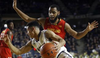 Maryland guard Eric Ayala, top, guards Navy guard Cam Davis in the first half of an NCAA college basketball game at the Veterans Classic tournament in Annapolis, Md., Friday, Nov. 9, 2018. (AP Photo/Patrick Semansky) ** FILE **