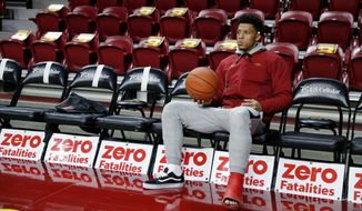 Injured Iowa State guard Lindell Wigginton sits on the bench before an NCAA college basketball game against Missouri, Friday, Nov. 9, 2018, in Ames, Iowa. (AP Photo/Charlie Neibergall)