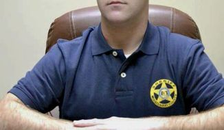 """FILE - In this undated file photo, Mississippi County Sheriff Cory Hutcheson sits behind his desk at the Mississippi County Detention Center in Charleston, Mo. The family of a mentally ill Tennessee man who died after being subdued at the Mississippi County, Missouri, jail in May 2017 is seeking $20 million in a federal lawsuit. Tory Sanders died at a hospital after a scuffle with then-Sheriff Hutcheson and other officers. The lawsuit alleges that Hutcheson ignored warnings from another officer to stop putting pressure on Sanders' neck, responding, """"No, I'm good."""" (Leonna Heuring/Sikeston Standard Democrat via AP, File)"""