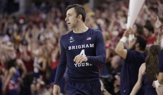 FILe - In this Feb. 25, 2017, file photo, BYU guard Nick Emery walks on the court during the first half of an NCAA college basketball game against Gonzaga in Spokane, Wash. The men's basketball program at Brigham Young University must vacate wins over two seasons and received two years of probation from the NCAA after one of its players received extra benefits. The NCAA said Friday, Nov. 9, 2018, that Nick Emery received more than $12,000 in benefits from four boosters, which included travel to concerts and an amusement park along with the use of a new car.  (AP Photo/Young Kwak, File)