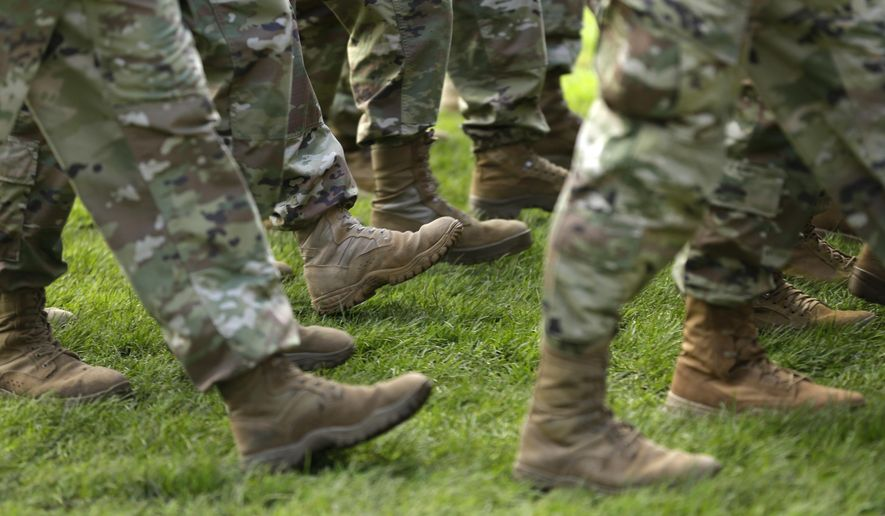 FILE- In this April 3, 2017, file photo U.S. Army soldiers march in formation during a change of command ceremony at Joint Base Lewis-McChord in Washington. If you're a veteran with student debt, you have repayment rights unique to military service members that can keep you on track and out of default. (AP Photo/Ted S. Warren, File)