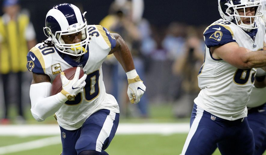 FILE - In this Sunday, Nov. 4, 2018, file photo, Los Angeles Rams running back Todd Gurley (30) carries for a touchdown in the first half of an NFL football game against the New Orleans Saints in New Orleans. Gurley, last year's Offensive Player of the Year, leads the NFL with 16 touchdowns. the fourth-year pro has scored at least one touchdown in each of the Rams' nine games this season. (AP Photo/Bill Feig)