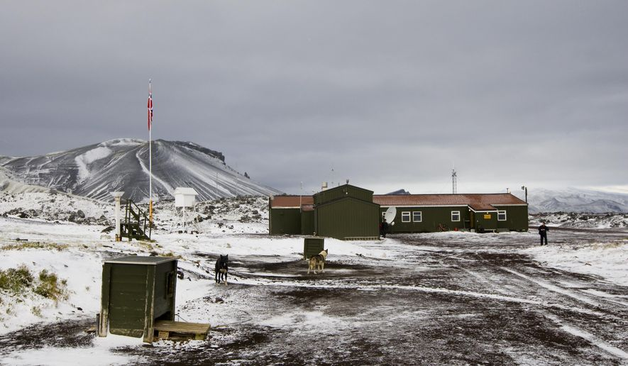 FILE - This Sept. 23, 2009 file photo shows the meteorological station on the Norwegan island Jan Mayen in the Arctic Sea. A powerful earthquake with a preliminary magnitude of 6.8 occurred some 120 kilometers (74 miles) off Jan Mayen on Friday Nov. 9, 2018, in the Arctic Ocean, northwest of a largely uninhabited and remote Norwegian island, officials said. No injuries or damage were immediately reported. (Heiko Junge/NTB Scanpix via AP)