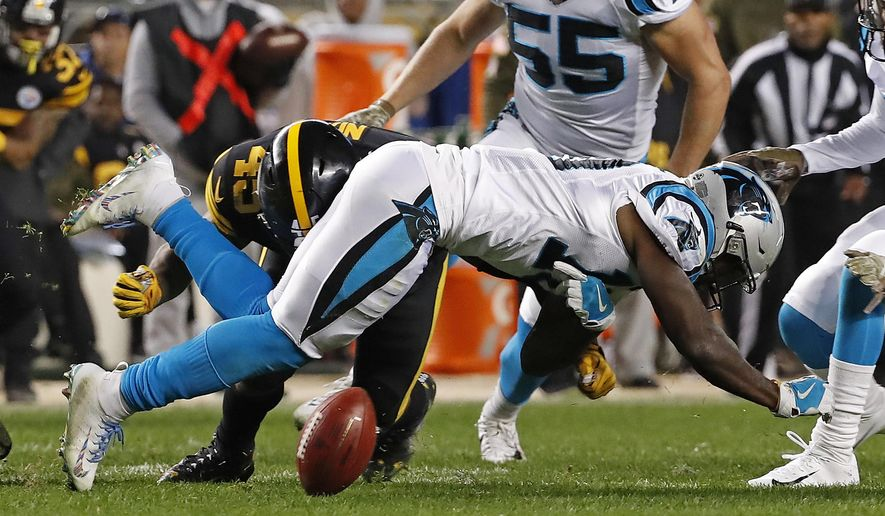 Carolina Panthers wide receiver Curtis Samuel (10) fumbles the ball after being hit by Pittsburgh Steelers fullback Roosevelt Nix-Jones (45) on a kickoff return during the second half of an NFL football game in Pittsburgh, Thursday, Nov. 8, 2018. The Steelers recovered the fumble. (AP Photo/Don Wright)